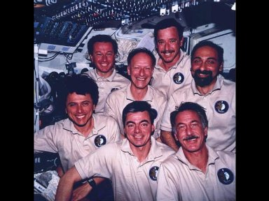 The traditional inflight crew portrait was taken with a pre-set 70mm camera on the flight deck of the Space Shuttle Columbia.