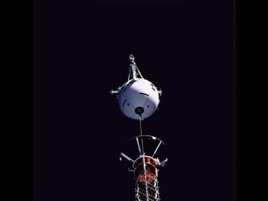 A medium close-up view, captured with a 70mm camera, shows the Tethered Satellite System (TSS) and part of its supportive boom device prior to deployment operations.