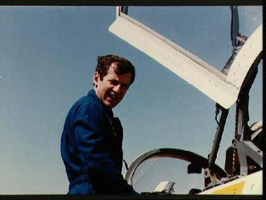 Astronaut Terry C. Hart boards T-38 for trip to KSC