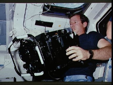 Astronaut Terry Hart prepares to use IMAX camera