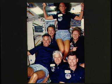 View of the STS 41-D crew in the middeck
