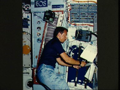 Payload specialist Charles Walker works with CFES experiment
