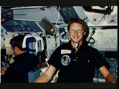 View of Mission specialist Steven Hawley on the flight deck
