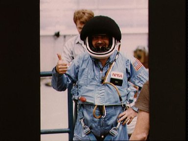 Payload Specialist Scully-Power in full flight suit with helmet