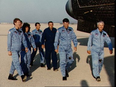 Crew of STS 41-D makes a visual post-flight inspection of orbiter