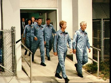41-D crew leaves operations and checkout building at KSC