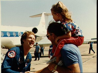 Astronaut Steven A. Hawley is greeted by well wishers after 41-D return