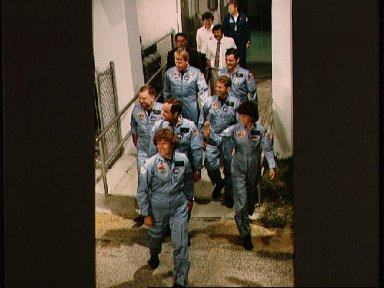 STS 41-G crew prepares to leave Operations and checkout bldg for launch