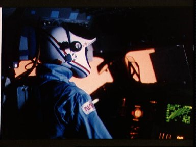 Astronaut Robert Crippen at commanders station during entry phase of flight