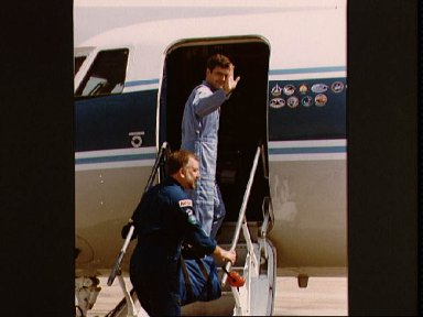 Payload Specialists Garneau and Scully-Power prepare to leave for KSC