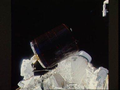 Astronauts Gardner and Allen during loading of Palapa B-2 in payload bay
