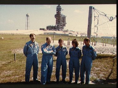 STS 51-A crew in training with shuttle Discovery on launch pad