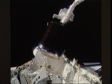 Astronauts Gardner and Allen during loading of Westar VI in payload bay