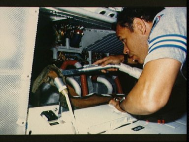 Astronaut Frederick Gregory vacuums air filters in avionics bay
