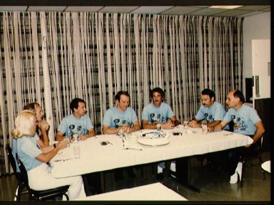 STS 51-D crewmembers gather to eat breakfast