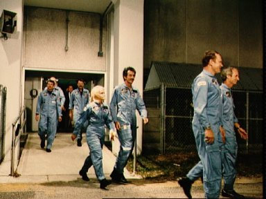 STS 51-D crewmembers depart KSC's operations and checkout building