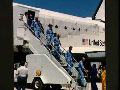 STS 51-F crew egress the orbiter and are greeted by George Abbey
