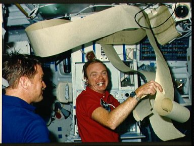 Astronauts Bridges and England surrounded by teleprinted messages