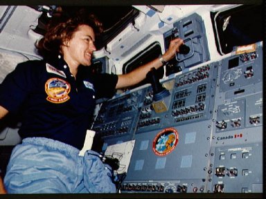 Astronaut Shannon Lucid monitors payload bay activities