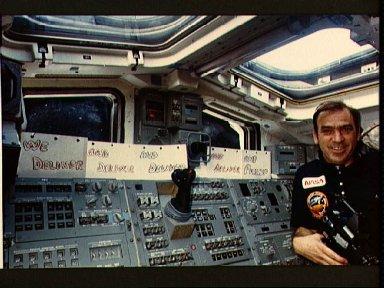 Astronaut John Fabian show off signs on aft flight deck