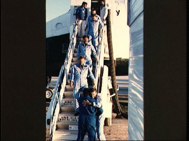 Crew of the STS 51-I Discovery mission egress the orbiter at Edwards AFB