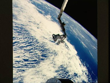 Astronaut James van Hoften on RMS tracking Syncom IV-3 after deployment
