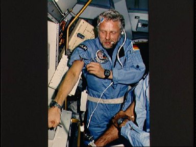 Payload specialist Reinhard Furrer show evidence of previous blood sampling