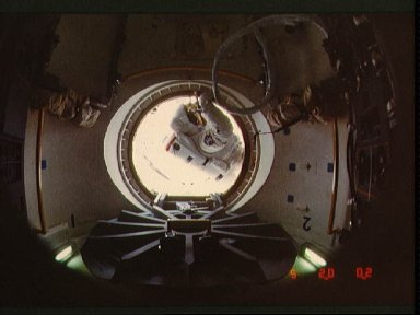 Astronaut Jerry Ross at threshold of airlock compartment following EVA