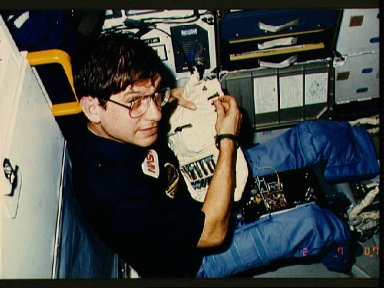 Payload specialist Robert Cenker after adjusting DSO equipment