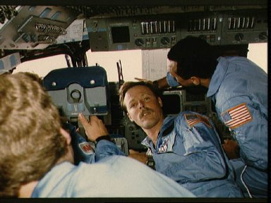 Four STS 61-C crewmembers gather at the commander's station