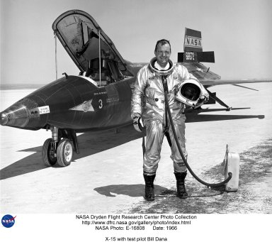 NASA research pilot Bill Dana is seen here next to the X-15 #3 rocket-powered aircraft after a flight. William H. Dana is Chief Engineer at NASA's Dryden Flight Research Center, Edwards, California. Formerly an aerospace research pilot at Dryden, Dana flew the F-15 HiDEC research aircraft and the Advanced Fighter Technology Integration/F-16 aircraft. Dana flew the X-15 research airplane 16 times, reaching a top speed of 3,897 miles per hour and a peak altitude of 310,000 feet (almost 59 miles high). The X-15 research aircraft was developed to provide in-flight information and data on aerodynamics, structures, flight controls, and the physiological aspects of high-speed, high-altitude flight. A follow on program used the aircraft as a testbed to carry various scientific experiments beyond the Earth's atmosphere on a repeated basis. The X-15 was a rocket-powered aircraft 50 ft long with a wingspan of 22 ft. It was a missile-shaped vehicle with an unusual wedge-shaped vertical tail, thin stubby wings, and unique side fairings that extended along the side of the fuselage. The X-15 weighed about 14,000 lb empty and approximately 34,000 lb at launch. The XLR-99 rocket engine, manufactured by Thiokol Chemical Corp., was pilot controlled and was capable of developing 57,000 lb of thrust. North American Aviation made 3 X-15 aircraft for the program. For flight in the dense air of the usable atmosphere, the X-15 used conventional aerodynamic controls such as rudder surfaces on the vertical stabilizers to control yaw and canted horizontal surfaces on the tail to control pitch when moving in synchronization or roll when moved differentially. For flight in the thin air outside of the appreciable Earth's atmosphere, the X-15 used a reaction control system. Hydrogen peroxide thrust rockets located on the nose of the aircraft provided pitch and yaw control. Those on the wings provided roll control. Because of the large fuel consumption, the X-15 was air launched from a B-52 aircraf