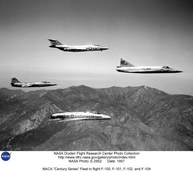 This NACA High-Speed Flight Station photograph of the Century Series fighters in formation flight was taken in 1957. The F-100 (lower center) had originally been built as a day fighter. The later versions were built as fighter bombers, with some seeing combat in Vietnam. The F-101 (top center) was designed as a long-range escort, but saw service as a fighter bomber, reconnaissance aircraft, and interceptor. The F-102 (right) was designed from the start as an all-weather interceptor, and was used in this role throughout its service life. The F-104 (left) was originally designed as a light-weight fighter, but ended up being used as an interceptor and fighter bomber. These aircraft were flown by the NACA as part of a loan agreement with the Air Force. The NACA learned a great deal from these flights, in return for which NACA research pilots made evaluation flights in support of Air Force development efforts. Such tests were a major NACA activity during the 1950s, and included work on the F-89, F-100, and F-104.