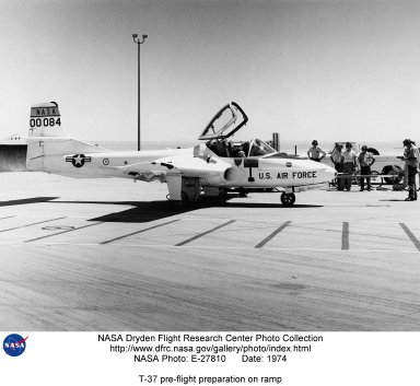 This T-37 was used by the NASA Dryden Flight Research Center, Edwards, California as a chase aircraft for many research flights. It was also used as a probe aircraft wake vortices for studies in support of the national effort to reduce the hazards associated with the trailed wake vortices of large aircraft. The effectiveness of using selected combinations of flap and spoiler positions on large aircraft to alleviate these air disturbances was evaluated by measuring the upsets imposed on these probe aircraft as they flew behind the large aircraft. The Cessna T-37B (60-0084) arrived at the NASA Flight Research Center in August 1974. On 8 November 1982, it crashed in a spin during a proficiency flight. NASA test pilot Richard E. Gray was fatally injured.