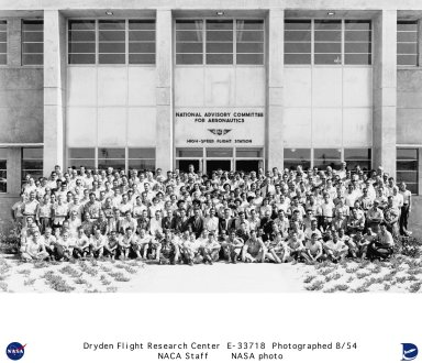 The employees of the NACA High-Speed Flight Station are gathered for a 1954 photo shoot on the front steps of building 4800, the new NACA Facility at Main Base of Edwards Air Force Base, California. This new building was considerably larger than the earlier NACA buildings on South Base, but then the staff had increased and the extra space was needed. From 1950 when an earlier group picture was taken (E-33717) until 1954 the staff at NACA increased from 132 to 250. As the workload increased and more research flights were completed the complement of employees grew to 662 in 1966. More changes took place in 1954 with the Station being called the NACA High-Speed Flight Station. A further name change occurred in October 1958 to the National Aeronautics and Space Administration (NASA) High-Speed Flight Station and again in September 1959 to the NASA Flight Research Center. There would be two more name changes before the next group photo (EC85-33160-2) would be made. On March 1976 to NASA Hugh L. Dryden Flight Research Center and in October 1981 when the Center became the Ames-Dryden Flight Research Facility.
