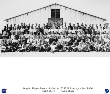 This group photo of National Advisory Committee for Aeronautics (NACA) employees was taken in 1950 in front of the NACA research building on South Base at Edwards Air Force Base, California. The team that had been established at Muroc Army Air Field in the later part of 1946 had grown to about 13 members at the beginning of 1947. In September of 1947 the group became known as the NACA Muroc Flight Test Unit with a complement of 27 employees by January 1948. In February 1948 the name of the base changed to Muroc Air Force Base and in 1949 would change again to Edwards Air Force Base. In November 1949 the NACA Muroc Flight Test Unit became the NACA High-Speed Flight Research Station. In January 1950 there were 132 employees with those numbers increasing to 196 by January 1952.