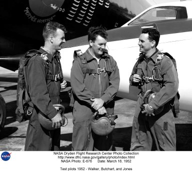 This photo shows test pilots, (Left-Right) Joseph A. Walker, Stanley P. Butchart and Walter P. Jones, standing in front of the Douglas D-558-II Skystreak, in 1952. These three test pilots at the National Advisory Committee for Aeronautics? High-Speed Flight Research Station probably were discussing their flights in the aircraft. Joe flew research flights on the D-558-I #3 (14 flights, first on June 29, 1951) investigating buffeting, tail loads, and longitudinal stability. He flew the D-558-II #2 (3 flights, first on April 29, 1955) and recorded data on lateral stability and control. He also made pilot check-out flights in the D-558-II #3 (2 flights, first on May 7, 1954). For fifteen years Walker served as a pilot at the Edwards flight research facility (today known as the National Aeronautics and Space Administration?s Dryden Flight Research Center) on research flights as well as chase missions for other pilots on NASA and Air Force research programs. On June 8, 1966, he was flying chase in NASA?s F-104N for the Air Force?s experimental bomber, North American XB-70A, when he was fatally injured in a mid-air collision between the planes. Stan flew the D-558-I #3 (12 flights, first on October 19, 1951) to determine the dynamic longitudinal stability characteristics and investigations of the lateral stability and control. He made one flight in the D-558-II #3 on June 26, 1953, as a pilot check-out flight. Butchart retired from the NASA Dryden Flight Research Center at Edwards, California, on February 27, 1976, after a 25-year career in research aviation. Stan served as a research pilot, chief pilot, and director of flight operations. Walter P. Jones was a research pilot for NACA from the fall of 1950 to July 1952. He had been in the U.S. Air Force as a pilot before joining the Station. Jones flew the D-558-I #3 (5 flights, first on February 13, 1951) to study buffeting, tail loads and longitudinal stability. Jones made research flights on the D-558-II #3 ( 7 flights, 