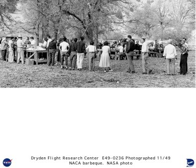 On a nice day in November 1949 the NACA High-Speed Flight Station employees enjoy a break from a week of research by attending a barbecue on the Rawliegh Duntley ranch. The food was excellent and the camaraderie with friends and family members was welcome. Games were played with the winners applauded--fun for everyone before the start of another week.