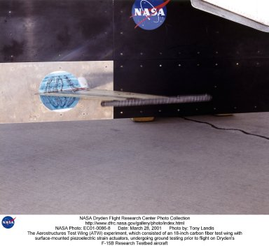 A flight experiment called the Aerostructures Test Wing (ATW) conducted at NASA's Dryden Flight Research Center, Edwards, Calif., successfully demonstrated a new software data analysis tool, the flutterometer, which is designed to increase the efficiency of flight flutter testing. The photo shows the experiment, which consisted of an 18-inch carbon fiber test wing with surface-mounted piezoelectric strain actuators, undergoing ground testing prior to flight. The test wing was mounted on a special ventral flight test fixture and flown on Dryden's F-15B Research Testbed aircraft. Five flights consisted of increasing speeds and altitudes leading to the final test point of Mach .85 at an altitude of 10,000 feet. At each Mach and altitude, stability estimations of the wing were made using accelerometer measurements in response to the piezoelectric actuator excitation. The test wing was intentionally flown to the point of structural failure, resulting in about a third of the 18-inch wing breaking off. This allowed engineers to record the effectiveness of the flutterometer over the entire regime of flutter testing, up to and including structural failure. Research objectives of the ATW experiment included validation of the new flutterometer, validation of aerodynamic load predictions on the test wing, and analytical strain gage calibration techniques.