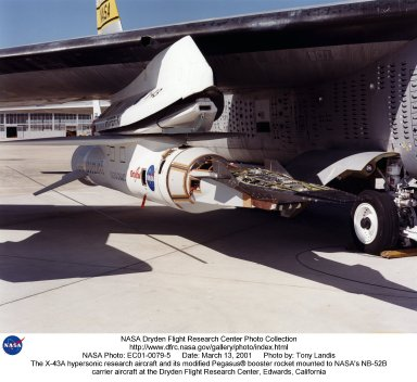 """The first of three X-43A hypersonic research aircraft and its modified Pegasus? booster rocket recently underwent combined systems testing while mounted to NASA's NB-52B carrier aircraft at the Dryden Flight Research Center, Edwards, California. The combined systems test was one of the last major milestones in the Hyper-X research program before the first X-43A flight. One of the major goals of the Hyper-X program is flight validation of airframe-integrated, air-breathing propulsion system, which so far have only been tested in ground facilities, such as wind tunnels. The X-43A flights will be the first actual flight tests of an aircraft powered by a revolutionary supersonic-combustion ramjet (""""scramjet"""") engine capable of operating at hypersonic speeds above Mach 5 (five times the speed of sound). The X-43A design uses the underbody of the aircraft to form critical elements of the engine. The forebody shape helps compress the intake airflow, while the aft section acts as a nozzle to direct thrust. The 12-foot, unpiloted research vehicle was developed and built by MicroCraft Inc., Tullahoma, Tenn., under NASA contract. The booster, built by Orbital Sciences Corp., Dulles, Va., will accelerate the X-43A after the X-43A/booster """"stack"""" is air-launched from NASA's venerable NB-52 mothership. The X-43A will separate from the rocket at a predetermined altitude and speed and fly a pre-programmed trajectory, conducting aerodynamic and propulsion experiments until it descends into the Pacific Ocean. Three research flights are planned, two at Mach 7 and one at Mach 10."""