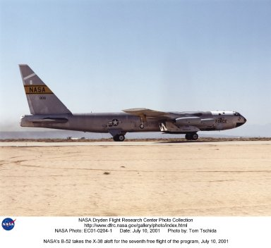 The X-38, mounted beneath the right wing of NASA's B-52, climbed from the runway at Edwards Air Force Base for the seventh free flight test of the X-38, July 10, 2001. The X-38 was released at 37,500 feet and completed a thirteen minute glide flight to a landing on Rogers Dry Lake.
