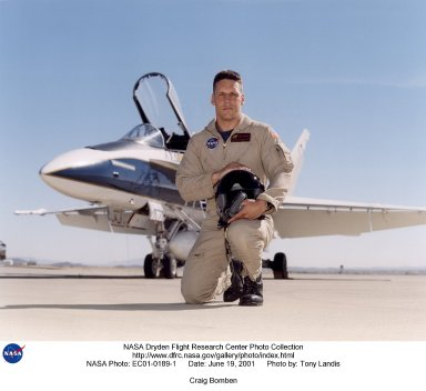 Craig R. Bomben became a pilot in the Flight Crew Branch of NASA's Dryden Flight Research Center, Edwards, Calif., in June 2001. His flying duties include a variety of research and support activities while piloting the F/A-18, DC-8, T-34C and King Air aircraft. He has more than 17 years and 3,800 hours of military and civilian flight experience in over 50 different aircraft types. Bomben came to NASA Dryden from a U.S. Navy assignment to the Personnel Exchange Program, Canada. He served as a test pilot in the Canadian Armed Forces located in Cold Lake, Alberta. He participated in numerous developmental programs to include CT-133 airborne ejection seat testing, F/A-18 weapons flutter testing and F/A-18 night vision goggles integration. Bomben performed U.S. Navy fleet service in 1995 as a strike-fighter department head. He completed two overseas deployments onboard the USS George Washington and USS Stennis. As a combat strike leader, he headed numerous multi-national missions over Iraq in support of Operation Southern Watch. Bomben graduated from the U.S. Naval Test Pilot School in 1992 and was subsequently assigned to the Naval Weapons Test Squadron at Pt. Mugu, Calif. During this tour he developed the F-14D bombsight and worked on various other F-14D and F/A-18 weapon systems developmental programs. Bomben is a 1985 graduate of Washington State University with a bachelor of science degree in electrical engineering. He graduated from naval flight training in 1987 and was recognized as a Commodore List graduate. His first assignment was to Naval Air Station Pensacola, Fla., where he was an instructor in the T-2B Buckeye. When selected to fly the F/A-18 in 1989, he joined a fleet squadron and deployed aboard the USS Forrestal. Bomben is married to the former Aissa Asuncion. They live in Lancaster, Calif., with their 3 children.