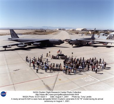 """A newly arrived B-52H is seen here alongside NASA Dryden's venerable B-52 """"B"""" model during its arrival ceremony on August 1, 2001. NASA Dryden Flight Research Center, Edwards, California, received the """"H"""" model B-52 Stratofortress aircraft on July 30, 2001. The B-52H will be used as an air-launch aircraft supporting NASA's flight research and advanced technology demonstration efforts. Dryden received the B-52H from the U.S. Air Force's (USAF) 23rd Bomb Squadron, 5th Bombardment Wing (Air Combat Command), located at Minot AFB, N.D. A USAF crew flew the aircraft to Dryden. The aircraft, USAF tail number 61-0025, will be loaned initially, then later transferred from the USAF to NASA. The B-52H is scheduled to leave Dryden Aug. 2 for de-militarization and Programmed Depot Maintenance (PDM) at Tinker Air Force Base (AFB), Oklahoma. The depot-level maintenance is scheduled to last about six months and includes a thorough maintenance and inspection process. It will take about one year for the B-52H to be ready for flight research duties. This time includes PDM, construction of the new pylon, installation of the flight research instrumentation equipment, and aircraft envelope clearance flights."""