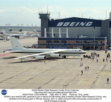 NASA's new white B-52H, destined to join a veteran B-52B mother ship at NASA's Dryden Flight Research Center, was exhibited at the Boeing plant in Wichita, Kansas, April 12, 2002 during the 50th anniversary commemoration of the B-52 series of aircraft.