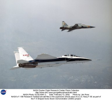 NASA's F-15B Research Testbed aircraft recently flew in the supersonic shock wave of a U.S. Navy F-5E in support of the F-5 Shaped Sonic Boom Demonstration (SSBD) project, part of the Defense Advanced Research Projects Agency's (DARPA) Quiet Supersonic Platform (QSP) program. The flights originated from the NASA Dryden Flight Research Center at Edwards, California. Four flights were flown in order to measure the F-5E's near-field (close-up) sonic boom signature at Mach 1.4, during which more than 50 shockwave patterns were measured at distances as close as 100 feet below the F-5E.