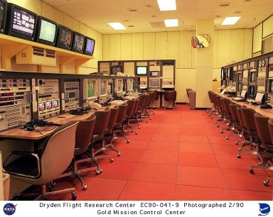 Mission control Gold room is seen here, located at the Dryden Flight Research Center of the Western Aeronautical Test Range (WATR). All aspects of a research mission are monitored from one of two of these control rooms at Dryden. The WATR consists of a highly automated complex of computer controlled tracking, telemetry, and communications systems and control room complexes that are capable of supporting any type of mission ranging from system and component testing, to sub-scale and full-scale flight tests of new aircraft and reentry systems. Designated areas are assigned for spin/dive tests, corridors are provided for low, medium, and high-altitude supersonic flight, and special STOL/VSTOL facilities are available at Ames Moffett and Crows Landing. Special use airspace, available at Edwards, covers approximately twelve thousand square miles of mostly desert area. The southern boundary lies to the south of Rogers Dry Lake, the western boundary lies midway between Mojave and Bakersfield, the northern boundary passes just south of Bishop, and the eastern boundary follows about 25 miles west of the Nevada border except in the northern areas where it crosses into Nevada.