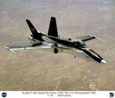The modified F-18 flown by NASA's Dryden Flight Research Center, Edwards, California, for high angle of attack research cruises over the nearby desert. A thrust vectoring system, linked to the aircraft's flight control system, was installed on each of the engine exhaust nozzles. The system moves a set of three paddles on each engine to redirect thrust for directional control and increased maneuverability at angles of attack at up to 70 degrees. Data from the F-18 high angle of attack program produced information to validate computer codes and wind tunnel results and led to design methods providing better performance in future aircraft.