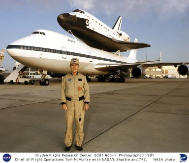 Thomas C. McMurtry in front of the 747 Shuttle Carrier Aircraft. He graduated in June 1957 from the University of Notre Dame with a Bachelor of Science degree in Mechanical Engineering. McMurtry had been part of the university's Navy ROTC program, and after graduation he joined the Navy as a pilot. Before retiring from the Navy in 1964 as a Lieutenant, he graduated from the U.S. Navy Test Pilot School, and had flown such aircraft as the F9F, A3D, A4D, F3D, F-8, A-6, and S-2. McMurtry was then a consultant for the Lockheed Corporation until joining NASA as a research pilot in 1967. While at the Dryden Flight Research Center, he was co-project pilot on the F-8 Digital Fly-By-Wire program, and the 747 Shuttle Carrier Aircraft, as well as project pilot on the F-15 Digital Electronic Engine Control (DEEC) project, the KC-135 Winglets, the F-8 Supercritical Wing project, and the AD-1 Oblique Wing Project. He also made research flights in NASA's YF-12C aircraft (actually a modified SR-71). McMurtry made the last glide flight of the X-24B lifting body on November 26, 1975, and was co-pilot of the 747 Shuttle Carrier Aircraft on the first free flight of the space shuttle Enterprise on August 12, 1977. He was involved in several remotely piloted research vehicle programs, including the FAA/NASA 720 Controlled Impact Demonstration and the 3/8 F-15 Spin Research Vehicle. During McMurtry's 32 years as a pilot and manager at Dryden, he received numerous awards. These include the NASA Exceptional Service Award for his work on the F-8 Supercritical Wing, and the Iven C. Kincheloe Award from the Society of Experimental Test Pilots for his role as chief pilot on the AD-1 project, the NASA Distinguished Service Medal, and the 1999 Milton O. Thomson Lifetime Achievement Award. McMurtry also held a number of management positions at Dryden, including Chief Pilot, Director of Flight Operations, Associate Director of Flight Operations, and was the acting Chief Engineer at the time of his r