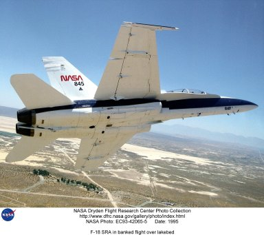 NASA's F/A-18 Hornet is seen here in a banked turn over Rogers Dry Lake in the Mojave desert on an early research flight. Currently being flown by NASA's Dryden Flight Research Center, Edwards, California, in a multi-year, joint NASA/DOD/industry program, the former Navy fighter has been modified into a unique Systems Research Aircraft (SRA) to investigate a host of new technologies in the areas of flight controls, airdata sensing and advanced computing. One of the more than 20 experiments being tested aboard the SRA F-18 is an advanced air data sensing system which uses a group of pressure taps flush-mounted on the forward fuselage to measure both altitude and wind speed and direction--critical data for flight control and research investigations. The Real-Time Flush Air Data Sensing system concept is being evaluated for possible use on the X-33 and X-34 resuable space-launch vehicles. The primary goal of the SRA program is to validate through flight research cutting-edge technologies which could benefit future aircraft and spacecraft by improving efficiency and performance, reducing weight and complexity, with a resultant reduction on development and operational costs.