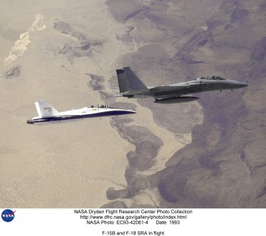 NASA's F-15B (upper right), later used for aerodynamic flight research, is seen here with the F/A-18B Systems Research Aircraft, on a flight from the Dryden Flight Research Facility, Edwards, California. Currently being flown by Dryden in a multi-year, joint NASA/DOD/industry program, the F/A-18B has been modified into a unique Systems Research Aircraft (SRA) to investigate a host of new technologies in the areas of flight controls, air data sensing and advanced computing. One of the more than 20 experiments being tested aboard the SRA F-18 is an advanced air data sensing system which uses a group of pressure taps flush-mounted on the forward fuselage to measure both altitude and wind speed and direction--critical data for flight control and research investigations. The Real-Time Flush Air Data Sensing system concept is being evaluated for possible use on the X-33 and X-34 reusable space-launch vehicles. The primary goal of the SRA program is to validate through flight research cutting-edge technologies which could benefit future aircraft and spacecraft by improving efficiency and performance, reducing weight and complexity, with a resultant reduction on development and operational costs. NASA's F-15B aircraft is being used by Dryden as an aerospace research aircraft. Certain experiments can be placed on the Flight Test Fixture, which is mounted under the fuselage. The research projects can then be subjected to different aerodynamic loads, speeds and temperatures. The F-15B, No. 836, was acquired in 1993 and is also used at Dryden as a research support aircraft.