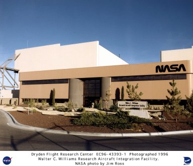 The NASA-Dryden Integrated Test Facility (ITF), also known as the Walter C. Williams Research Aircraft Integration Facility (RAIF), provides an environment for conducting efficient and thorough testing of advanced, highly integrated research aircraft. Flight test confidence is greatly enhanced by the ability to qualify interactive aircraft systems in a controlled environment. In the ITF, each element of a flight vehicle can be regulated and monitored in real time as it interacts with the rest of the aircraft systems. Testing in the ITF is accomplished through automated techniques in which the research aircraft is interfaced to a high-fidelity real-time simulation. Electric and hydraulic power are also supplied, allowing all systems except the engines to function as if in flight. The testing process is controlled by an engineering workstation that sets up initial conditions for a test, initiates the test run, monitors its progress, and archives the data generated. The workstation is also capable of analyzing results of individual tests, comparing results of multiple tests, and producing reports. The computers used in the automated aircraft testing process are also capable of operating in a stand-alone mode with a simulation cockpit, complete with its own instruments and controls. Control law development and modification, aerodynamic, propulsion, guidance model qualification, and flight planning -- functions traditionally associated with real-time simulation -- can all be performed in this manner. The Remotely Augmented Vehicles (RAV) function, now located in the ITF, is a mainstay in the research techniques employed at Dryden. This function is used for tests that are too dangerous for direct human involvement or for which computational capacity does not exist onboard a research aircraft. RAV provides the researcher with a ground-based computer that is radio linked to the test aircraft during actual flight. The Ground Vibration Testing (GVT) system, formerly housed in the Thermostructural Laboratory, now also resides in the ITF. In preparing a research aircraft for flight testing, it is vital to measure its structural frequencies and mode shapes and compare results to the models used in design analysis. The final function performed in the ITF is routine aircraft maintenance. This includes preflight and post-flight instrumentation checks and the servicing of hydraulics, avionics, and engines necessary on any research aircraft. Aircraft are not merely moved to the ITF for automated testing purposes but are housed there throughout their flight test programs.